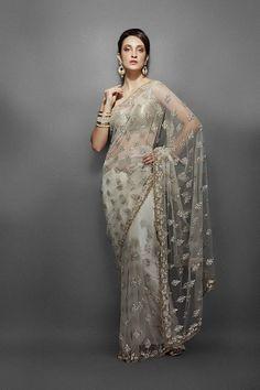 Z Fashion Trend: IVORY NET SAREE WITH SLEEVELESS BLOUSE