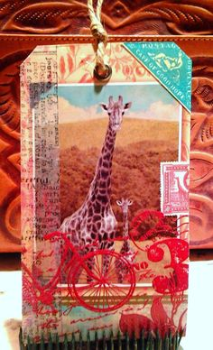 Repurposed card embellished with rubber stamps (turquoise stamp, red bike and number) and washi by Laura Turner