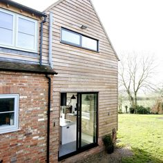 A double height contemporary extension in Buckinghamshire showcasing aluminium windows, aluminium bifold doors and a large gable end window from Hedgehog Aluminium Systems. Aluminium Sliding Doors, Aluminium Windows, Patio Doors, Garage Doors, Indoor Outdoor Living, Outdoor Decor, Decking, Contemporary Architecture, Natural Light
