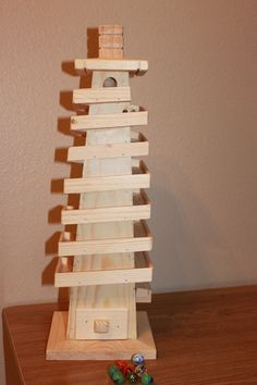 Wooden Marble Run Tower Game. $50.00, via Etsy.