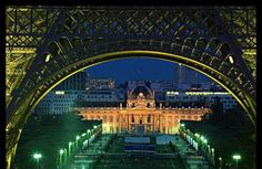 Ecole Militaire seen through the arches of the Eiffel Tower