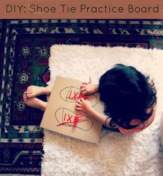 shoe tie practice board-used the lid off a shoe box and just traced one shoe.