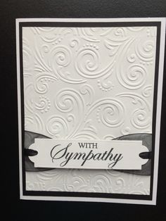 "Sympathy card using Spellbinders Back to Basics Tags die and ""With Sympathy""clear stamp. 5x6.5"" pre-made white card was layered with black card stock and white card stock embossed with Paper Studio - Intricate Swirl embossing folder. Sheer black ribbon and small black satin ribbon were used behind the label and tucked under the white card stock layer. Created by: Melanie Weise"