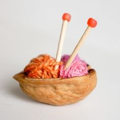 Perfect little miniature for the Fairies. A walnut shell yarn basket with toothpick knitting needles.