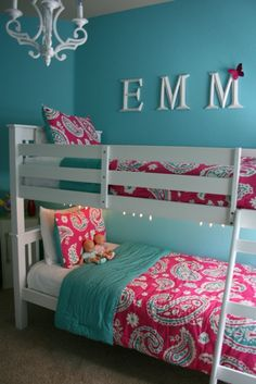 Love this color scheme for Cammies room with white queen bed from Ikea. Definitely like the chandelier.