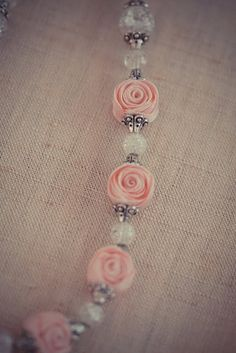 rickrack roses: a tutorial from atticgals.blogspot.ca....cute and easy!  Isn't this an adorable necklace.