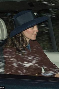 Kate Middleton wearing Hobbs Unlimited Celeste Flared Coat, L.K.Bennett Addison Dress and Lock and Co. Tiffany Drop-Brim Hat in Navy