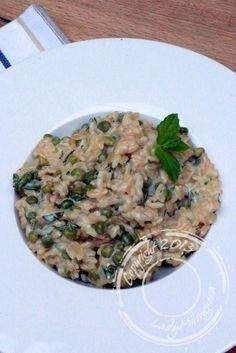 A la recherche d'une recette simple pour un repas du soir, j'ai tout de suite flashé sur cette proposition de risotto publiée sur le blog Tangerine zest.En effet, j'ai toujours un stock de riz arbo…