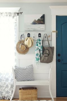 Small entry way with bench and coat rack - blue front door
