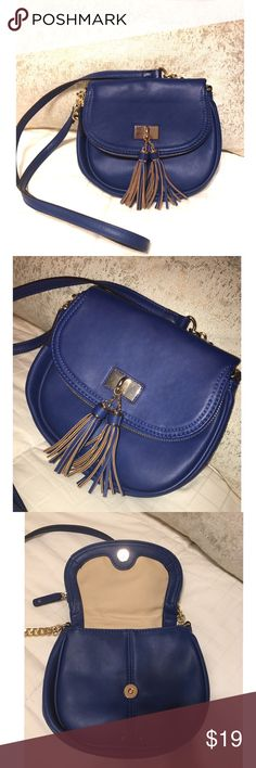 Aldo Crossbody Bag with fringe Adorable Blue Aldo crossbody bag with fringe tassels.   *Wrapped up with tissue paper and thank you note  *Extremely quick shipping    *Thanks for your support!   *TAGS ONLY NOT: huda beauty MAC Kardashian Free People Bebe Bcbg Juicy Smashbox Anthropologie H&M Marc Jacobs Victoria's Secret Nasty Gal Urban Outfitters follow Kylie contouring contour matte kabuki blush lip palette date night classy sexy summer wedding bridesmaid jewelry Statement necklace shoes…