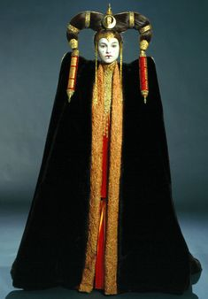 Padmé Naberrie Amidala, Queen and later senator of Naboo, maintained a large wardrobe of extravagant, ornate and in some cases very elaborate disguises, dresses, and robes of office throughout her life. As a Princess of Theed, her dresses were more simple, geared more towards practicality than style. However, her robes and dresses during her terms as Queen were ornate and uniquely styled, geared highly towards Naboo tradition rather than comfort. After her second term as Queen ended, she...