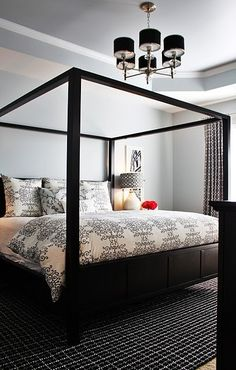 four poster bed, black and white room