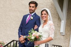 Marcello looks cute in his navy suit and pink tie with his lovely bride, Katie. Photo by: Jon Koch Photography | Wedding Planning: Cosmopolitan Events
