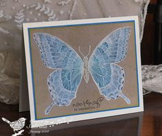 handmade card: Swallowtail Fun by Cook22 ... kraft main panel ... butterfly stamped in white and painted in diluted white ... final coloring in blues and aquas ... lovely combo with the krafte ... Stampin'Up!