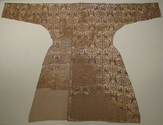 Coat Date: 11th–12th century Geography: probably Spain, possibly Eastern Iran Medium: Silk; samite Dimensions: Textile: L. 68 7/8 in. (175 cm) W. across sleeves: 50 3/8 in. (128 cm) W. across skirt: 37 in. (94 cm) Accession Number: 2008.346a-c The Metropolitan Museum of Art