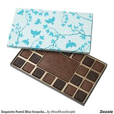 "Exquisite Pastel Blue branches and birds 45 Piece Box Of Chocolates  Nothing says ""Happy Mother's day"" than a box of delicious chocolates. Each chocolate takes on a character of it's own with each illustration. The box includes an attractive and soft pastel blue bird and branch design. Place your order today! #mothersday #chocolates"