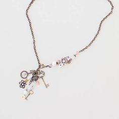 Adrienne necklace has five charms and a side cluster to bling out your style  $25 Www.plunderdesign.com/maryswinney