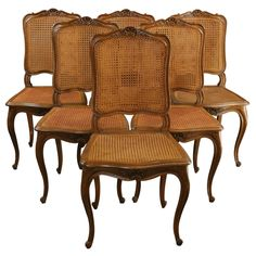 """Seller says , """"Ooh-la-la is the phrase on your lips when you see this gorgeous set of 6 antique dining chairs in the Louis XV style. A direct import from France, the antique dining chairs date to circa 1900 and they pack the pretty punch that you expect from Louis XV furniture."""""""