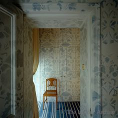 A blue and white stencilled motif covers the walls and doors of this bedroom corridor in London, England. GO PAINT YOUR WALLS. Dressing Area, Blue And White China, Types Of Houses, Cool Rooms, Corridor, House Painting, Arches, White Porcelain, Foyer