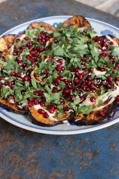 BARBQUED EGGPLANT WITH TAHINI DRESSING AND POMEGRANATES