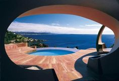 funnywildlife:    Palais Bulles This is designer Pierre Cardin's home. Also known as Palais Bulles (Bubbles Palace) near Cannes. It has 10 suites decorated by a different artist for each suite, a reception seating 350 persons, and an outdoor auditorium for 500 persons, all surrounded by acres and acres of stunning gardens.