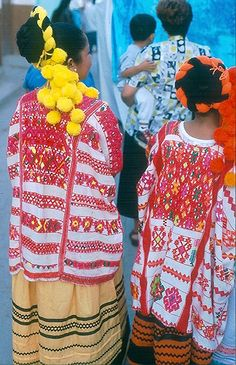 "huipiles. Pronounced ""wee peel."" My mom was in the Peace Corps in Guatemala in the 68 and worked with Indian women who wore these. They were facinated by her long blonde hair."