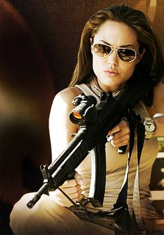 Angelina Jolie in Mr. & Mrs. Smith! She is an undercover agent, everyday ready to kill! In this movie Angelina Jolie is very feminine however shows some masculine attributes as well such as no fear to kill, being strong and powerful also values Johnnie Walker stands for.