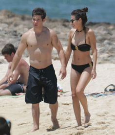 Pitch Perfect's Adam DeVine shows off his PDA moves with girlfriend Chloe Bridges at the beach. Click through to see the hot pictures!