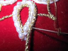 All Things Russian: Pearl Embroidery Pearl embroidery with a white yarn under layer and gold cord to either side.