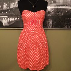 BeBop Polka dot Dress Orange and white polka dot strapless dress. Actually it has clear straps if you want to wear them. Size XS. Length 25 inches. 97% Cotton and spandex blend. Excellent condition! BeBop Dresses Strapless