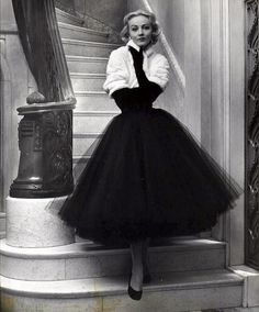1951 ~ White shawl-collared ermine jacket by Maximilian