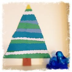 Make a holiday tree with some fun colors. I saw this color combination at Pier one imports and just had to create something fun for the little ones! :) What you'll need: Construction paper of teal ...