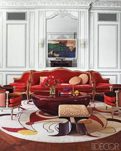 Francophile Fantasy in New York-In the living room, the canapé à confident is Louis XV and the bergères are Louis XVI; the cocktail table is by Mattia Bonetti, the stool is by Michel Boyer, the sconces are 1950s Italian, and the rug is by Diurne.