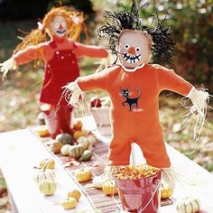 <p>Put your baby's too-small overalls and onesies to good use with this mini-scarecrow centerpiece. Stuff the outfit with fresh straw and create a head out of a burlap sack.  Then, let it stand guard to protect against candy corn snatchers.</p>