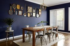 """At Aubre's <a href=""""https://www.homepolish.com/mag/a-chicago-writers-jeweled-home"""" target=""""_blank"""">Chicago home</a>, Homepolish's Megan Born brought a complete redesign to the dining room with industrial metal chairs and a folky wooden table."""