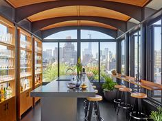 "Architectural Digest:  Rupert Murdoch's former NYC/SoHo apartment, 10,000+ sq. ft.  Re-designed for a new owner by Christine and John Gachot of Gachot Studios. Here, the triplex's ""sky bar"". with barrel-vaulted teak celing painted steel beams that complement teak cabinetry by William Somerville and a Kern/Rockenfield island topped with granite. Bar-stools are vintage Jean Prouvé. Has a barrel-vaulted teak ceiling, decorated by SoHo NYC apartment that used to belong to Rupert Murdock…"