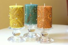 Orange, Yellow or Blue candle with intricate Henna design all-around on Etsy, $19.99