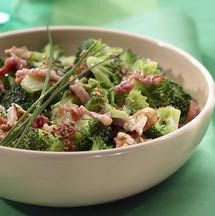 Most traditional broccoli salad recipes have a fair amount of sugar, due to raisins as well as sugar in the dressing. I've attempted to reduce the sugar, but keep the same salty-sweet flavor combination of the classic cold broccoli salad, with bits of bacon and sunflower seeds.