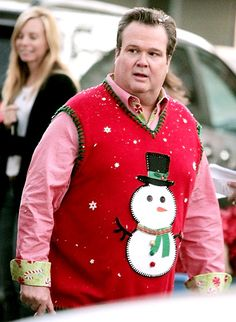 A very Modern Family Christmas! Stonestreet got into character in a snowman sweater while filming scenes for Modern Family.