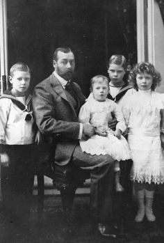 King George V then Prince of Wales who ascended the British throne in 1910 with four of his six children