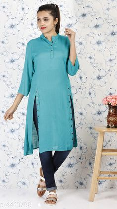 Tops & Tunics Women Blue Solid Top Fabric: Rayon Sleeves: Sleeves Are Included Size: S- 36 in M- 38 in L- 40 in XL- 42 in XXL- 44 in Length: Up To 38 in Type: Stitched Description: It Has 1 Piece Of Tunic Pattern: Button Work Country of Origin: India Sizes Available: S, M, L, XL, XXL   Catalog Rating: ★4 (550)  Catalog Name: Alana Voguish Tops & Tunics Vol 3 CatalogID_634534 C79-SC1020 Code: 363-4410798-198