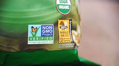 Bag of popcorn with Non GMO Project sticker.The Fight Over GMO Labeling Rages on Capitol Hill