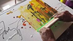 Demonstration of abstract painting in acrylics just using rubber squeegee.