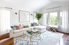 House Tour: A California Cool Home with Parisian Charm |  the sun-kissed home retains many of their staple pieces — like a vintage-inspired West Elm bar cart, vintage club chair, vintage brass coffee table, and bistro dining set — the space, as a whole, has a new type of charm.