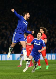 Eden Hazard of Chelsea celebrates after scoring his team's second goal from the penalty spotduring the UEFA Champions League Round of 16, second leg match between Chelsea and Paris Saint-Germain at Stamford Bridge on March 11, 2015 in London, England.