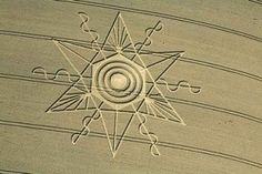 August 15, 2014 – August 13th Wheat Pattern in Dorset, England.  On August 13, 2014, this approximately 200-foot-diameter pattern emerged in wheat at Gussage St. Andrew near Sixpenny Handley, Dorset, England, southwest of Salisbury. Aerial image © 2014 by Lucy Pringle.