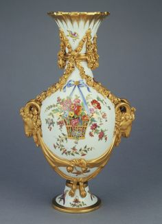 Pair of Vases (vases bouc du Barry B) -- Painted by Fallot (French, active Sèvres, France 1764 - 1790) -- Gilded by Jean Chauvaux le jeune (French, 1735 - 1807, active at Sèvres, France 1764 - 1800) -- Sèvres Manufactory (French, active 1756 - present); Sèvres, France; November 1778 -- Hard-paste porcelain, polychrome enamel decoration, silvering and gilding