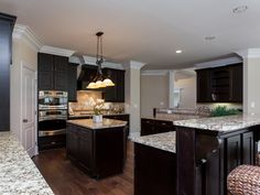 Deep espresso cabinets with light granite countertops New Home Kitchens | Photo Gallery | Jeff Benton Homes