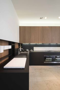 Kitchen top in FENIX NTM - gives this kitchen a minimal interior design! Check out FENIX NTM at na.rehau.com/surfaces.