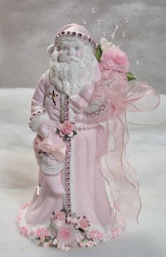 Shabby Chic Style Santa done in pink and white with lots of shiny glass glitter, roses and trims.